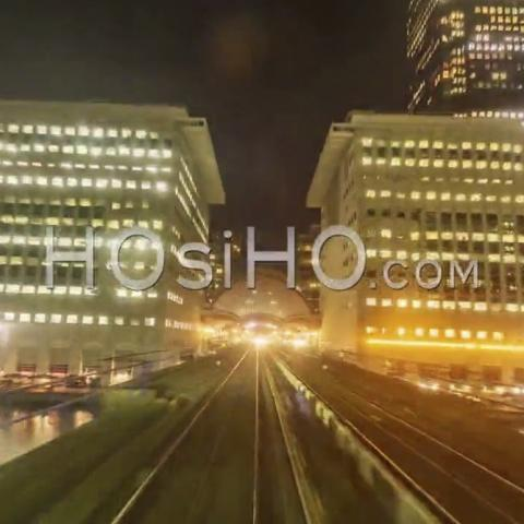 Hyperlapse Of The Docklands In London In Motion From A Fast Moving Train At Night, United-Kingdom